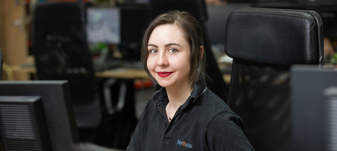 Customer Service Manager, Elena Henderson, working at her computer