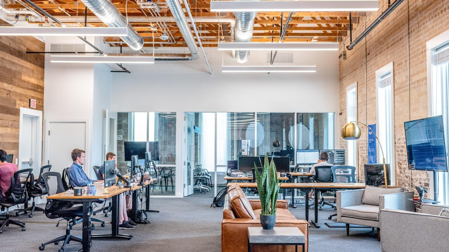 An open-plan office with staff working at their desks