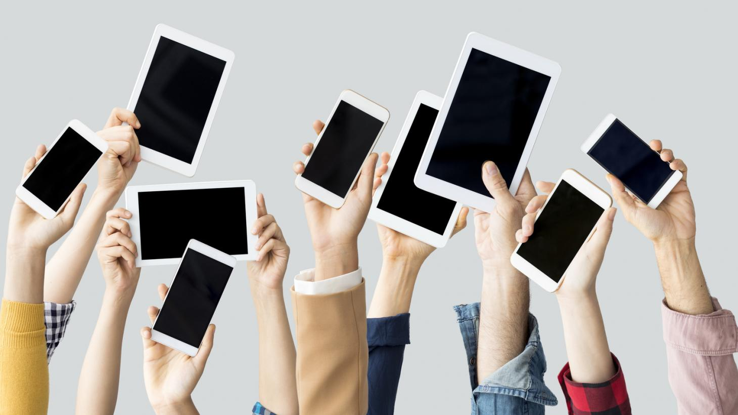 Tablets and phones being held up