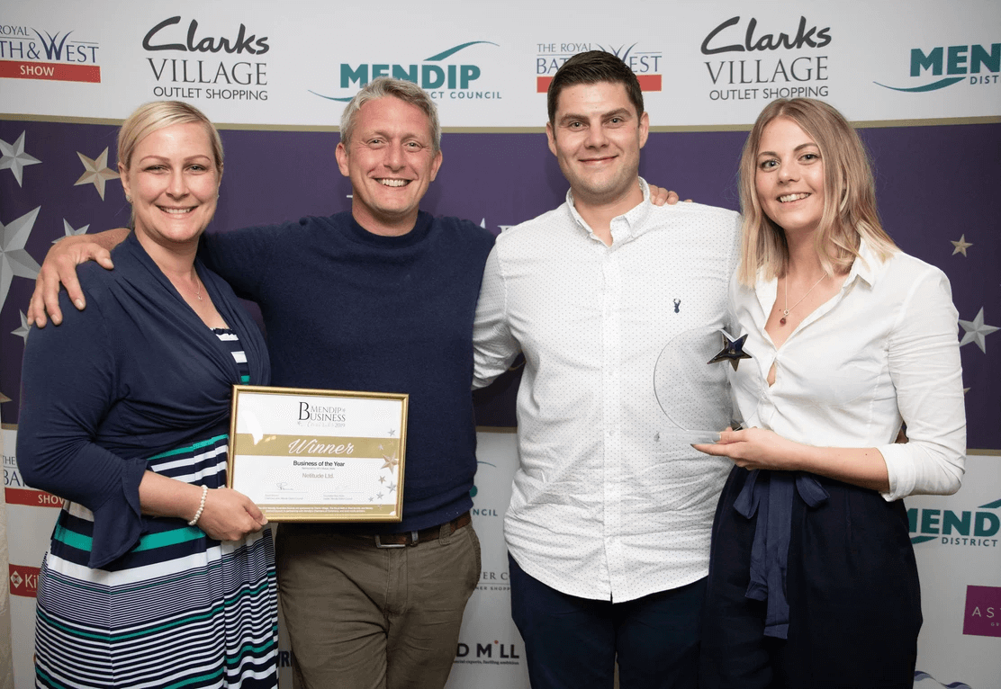 Netitude Founder and Managing Director, Adam Harling, with long standing team member, Josh Bradley accepting the business award.