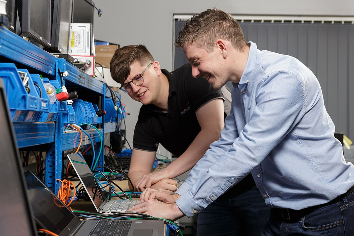 Project Engineers setting up a laptop for a client
