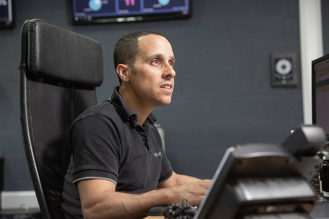 Operations Centre Manager working at his desk