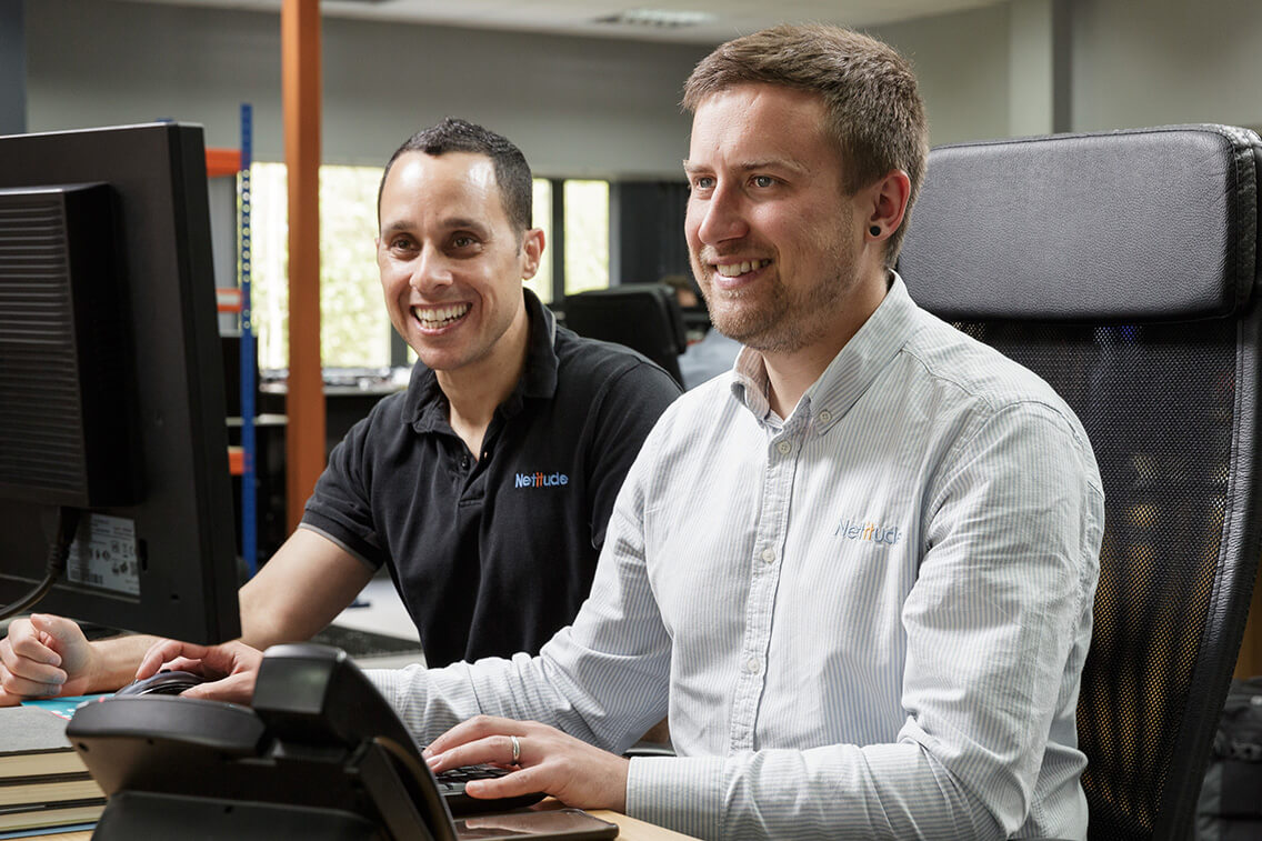 Engineers working at a computer together