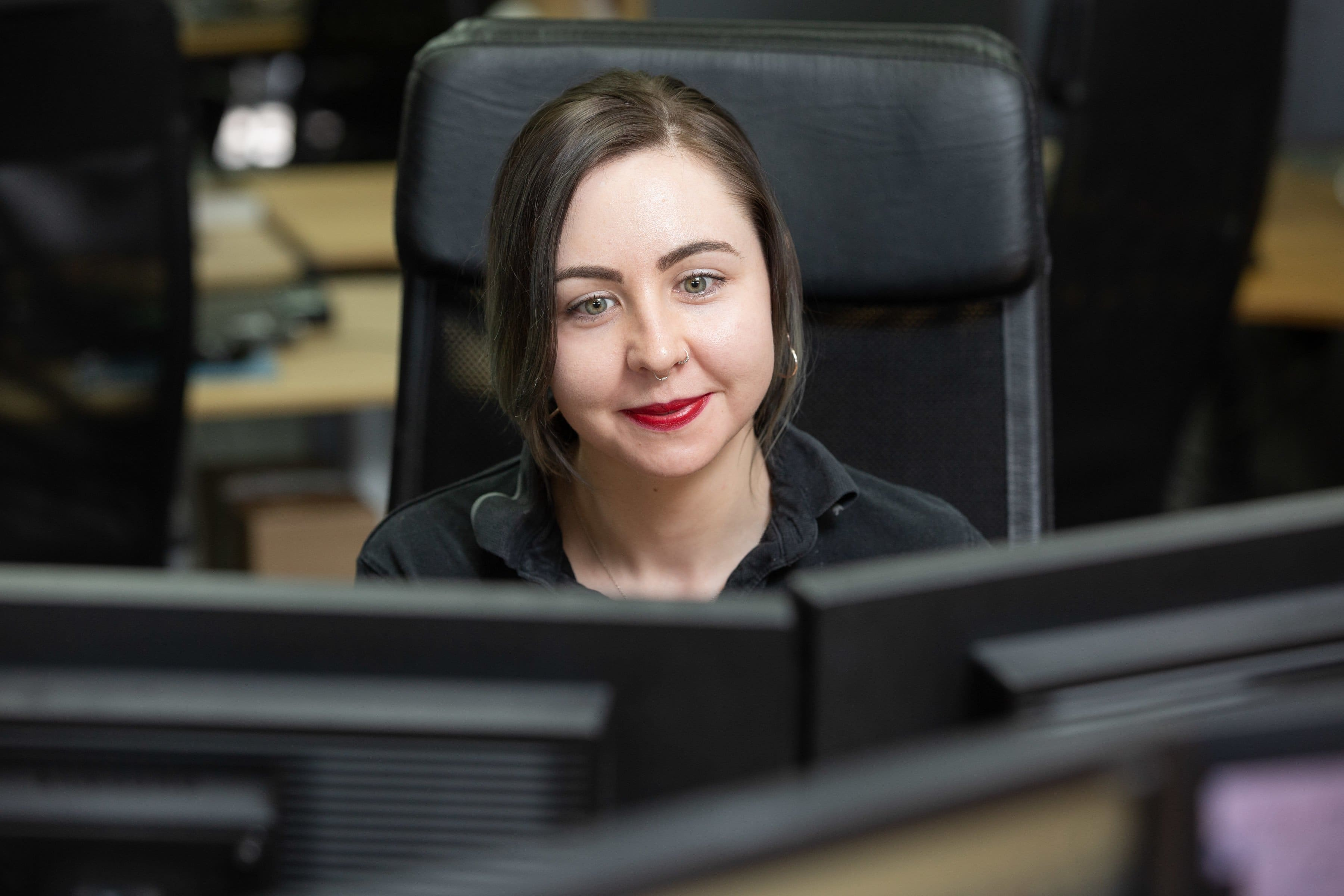 Customer Service Manager, working at her computer