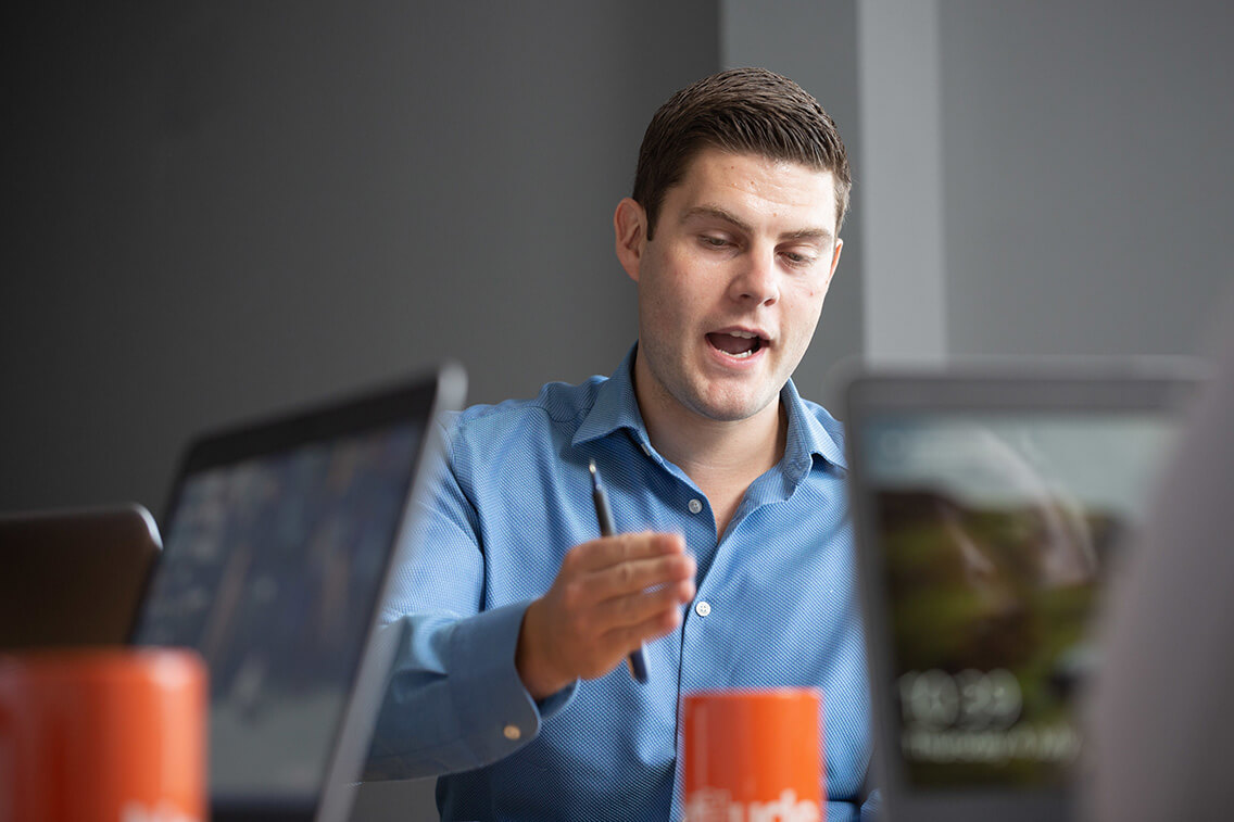 Virtual IT Director talking in a meeting with colleagues not seen in picture