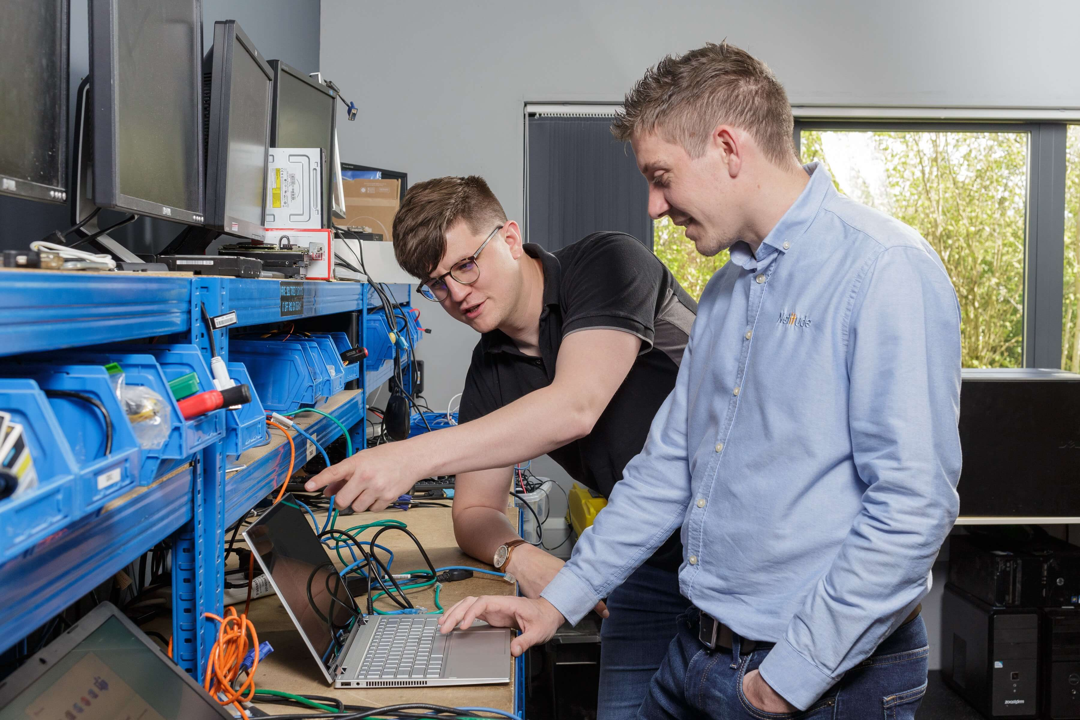Two young male engineers setting up